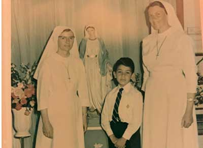 Nicholas Harsas (now Brother) First Holy Communion at Our Lady Queen of Peace Catholic Primary School Gladesville, with Sister Patricia Dawson rsm (Principal) and Sister Janet Weston rsm (Year 2 Teacher) in 1972