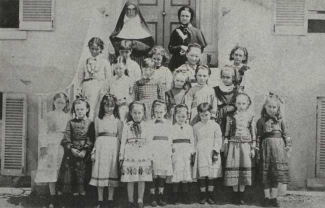 Sr Mary Borgia Byrne and novice Miss Mary Fitzgerald with students, All Hallows primary school Adderton House Brisbane in 1870