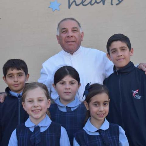 Principal Brother Nicholas Harsas fsp OAM with students at Holy Spirit Catholic Primary School Carnes Hill