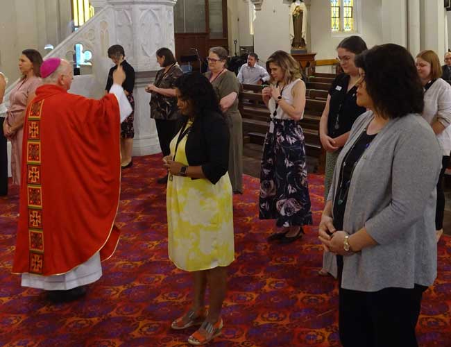 Bishop of Toowoomba Robert McGuckin and Catholic Schools staff at the commencement Mass.