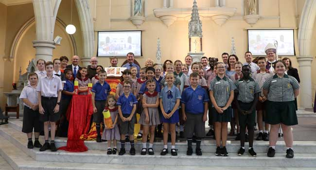Students and staff with Auxiliary Bishop of Brisbane Ken Howell at St Mary's Church in Ipswich.