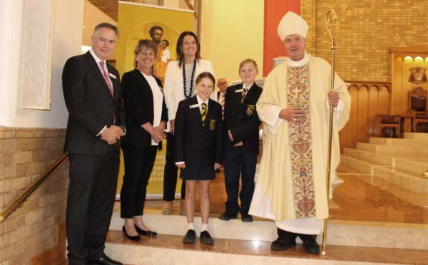 Director Ross Fox, St Joseph's Primary School, Bombala principal Susan Tighe, REC Alice Shannon and students Miller Stewart and Connor Reed with Archbishop Christopher Prowse at St Christopher's Cathedral Canberra