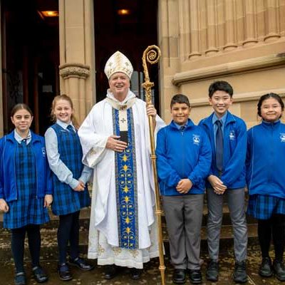 St Jerome's Catholic Primary School Punchbowl student with Archbishop of Sydney Anthony Fisher OP. Photo by Giovanni Portelli