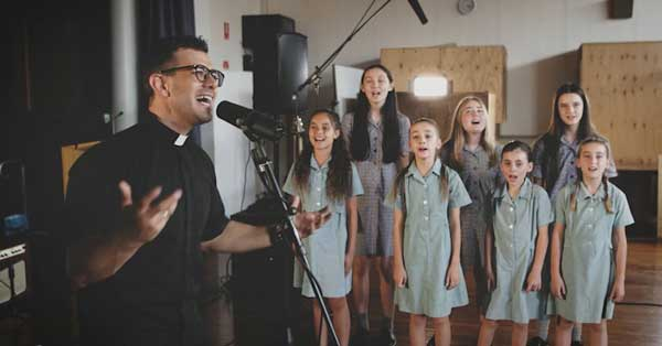 Fr Rob Galea and Notre Dame College students sing Faith in the Future Shepparton, VIC
