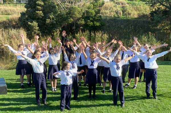 National song composer Fr Rob Galea made a visited St John's Richmond in Tasmania to surprise students who took part in the Faith in the Future Australian Student Version Video