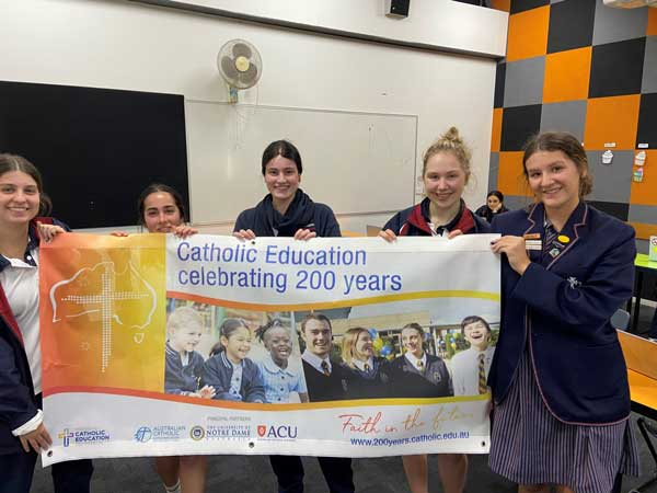 Students with their 200 years banner at Our Lady of Mercy College, Heidelberg VIC.