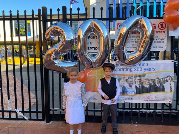 Students celebrate in historical dress at St Catherine Labouré Gymea, NSW. Source Sydney Catholic Schools,