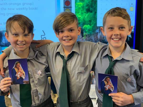 Students with the 200 years lapel pins and prayer cards at St Mary of the Angels Primary Guyra, Diocese of Armidale, NSW.