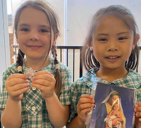 St Patrick's Catholic Primary School Summer Hill students with their 200 years prayer card & lapel pin.