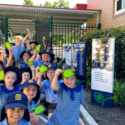 Kindergarten students from Holy Cross Catholic Primary, Helensburgh, with their new school timeline. Source: Catholic Education Diocese of Wollongong.