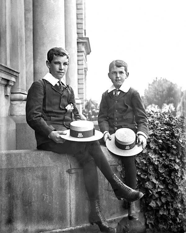 Two Xavier College students sit proudly on the front steps of the Senior Campus South Wing in an early publicity photograph