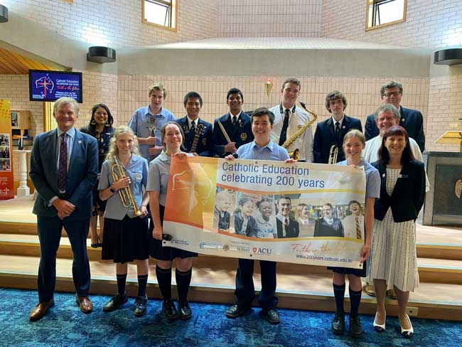 Students with 200 years banner, source Diocese of Bathurst