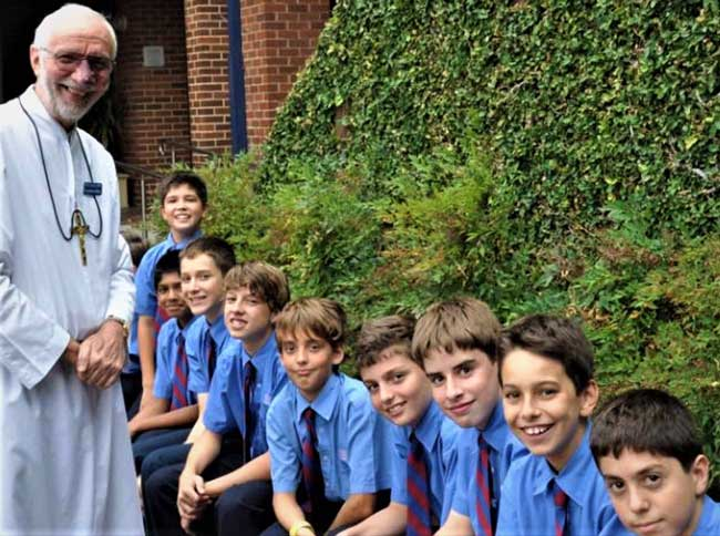 Br Joachim and students from Marcellin College, Randwick. Source Marist Brothers Australia.